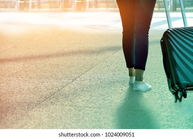 people and traveling luggage walking in air port terminal building with sunlight on street
