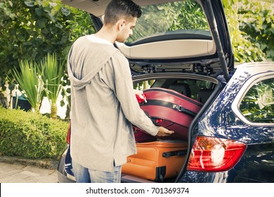 people travelling by car with suitcases and luggage