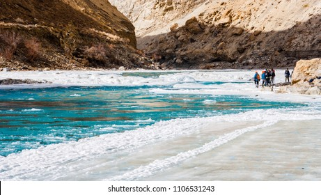 People trekking on frozen zanskar river. Chadar trek. Ladakh. India