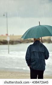 people with umbrella walking under the rain