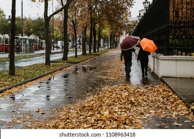 People with umbrellas walkin in Vienna, Austria