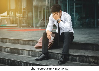 People unemployed businessman stress sitting on stair, concept of business failure and unemployment problem.