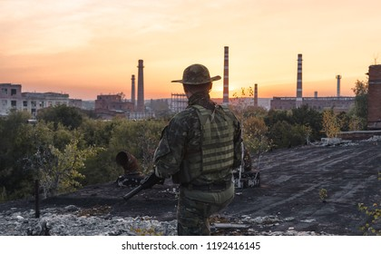 the people in uniform with weapons in the ruins