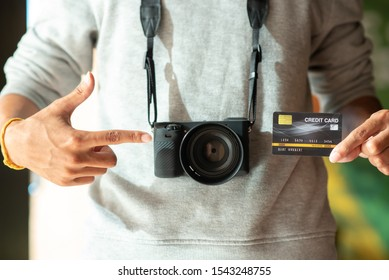 People use credit cards to buy cameras.
