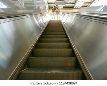 People use escalator to go up from the underground train station