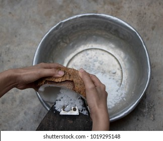 people are using grated coconut to make a tool for coconut milk as ingredients in cooking