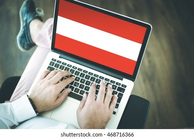 People using laptop and showing on the screen the flag of AUSTRIA