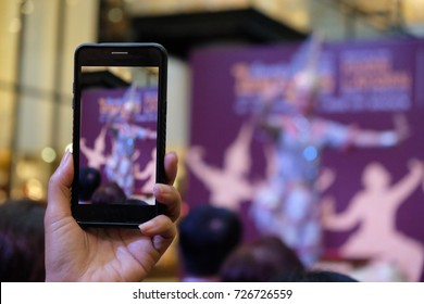 People are using the mobile phone to take pictures of the stage.