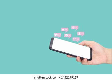 people using mobile smartphone with blank white screen for social media interactions with notification icons from friend in social network with like, message, email, mention and star above smartphone