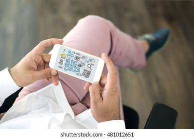People using smart phone and BIG DATA concept on screen