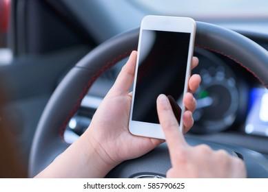 People using smart phone in car.