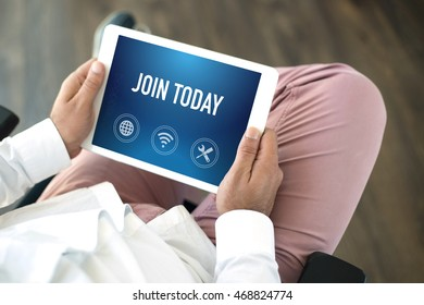 People using tablet pc and JOIN TODAY concept on screen