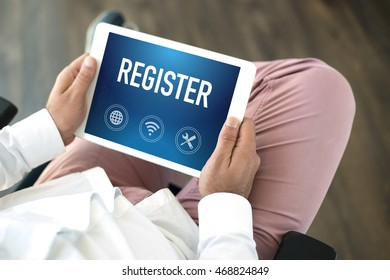 People using tablet pc and REGISTER concept on screen