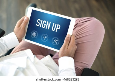 People using tablet pc and SIGN UP concept on screen