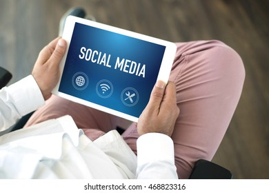 People using tablet pc and SOCIAL MEDIA concept on screen