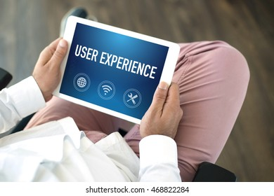 People using tablet pc and USER EXPERIENCE concept on screen