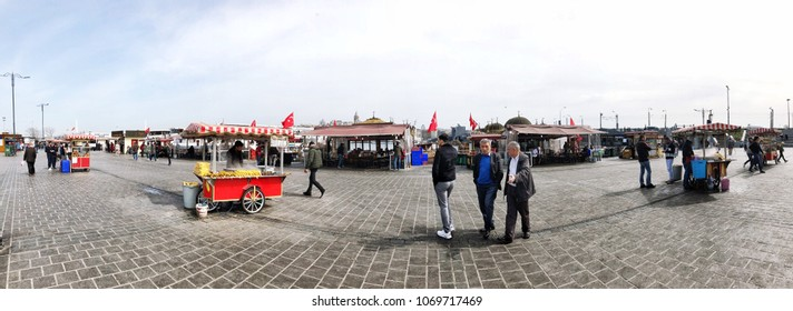 People and vendors on Eminonu square is a popular place in Istanbul, Turkey.