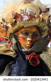 people at venice mask festival in italy