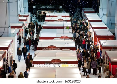 People visit the design trade show booths in the crowded hall of Ideal Home Show Christmas in London on November 13, 2013. The show brings exhibitors in categories including furniture, food, gadgets