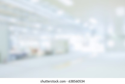 People visit a trade show. Background with an intentional blur effect applied. Humans and location not recognizable.