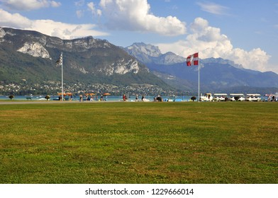 people visiting annecy in savoy next to the lake during summer holidays