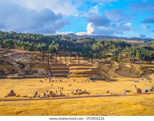 People visiting the old temple of Saqsayhuaman on a sunny day