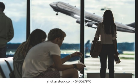 people waiting for airplane departure