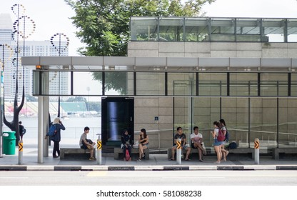 People are waiting for the bus at the bus stop at Marina bay, Singapore. This picture was taken on the 8th of February, 2017
