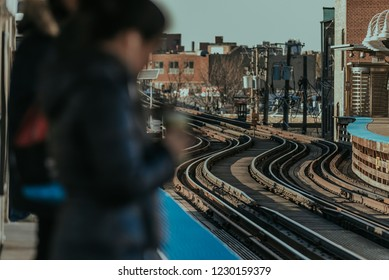 People Waiting for a City Train