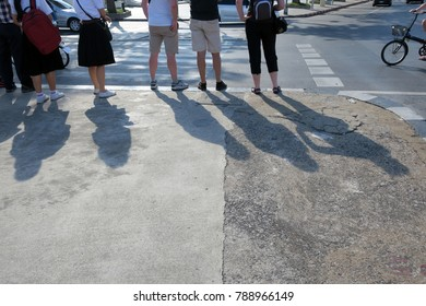 people waiting cross the road