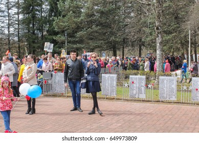 People are waiting in line for eternal fire. Kirishi, Russia - 9 May, 2017. Laying wreaths and flowers in memory of the fallen at the Eternal Flame.