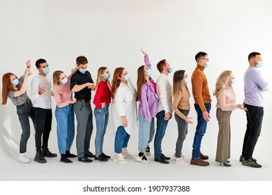 people waiting in line practising social distancing at city shop, in queue. new normal lifestyle concept with people wearing face mask on urban queue, people stand outraged. isolated studio shoot