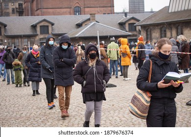 People waiting in line queued up for health screening for Coronavirus Covid-19 testing or vaccine at city test center. Copenhagen, Denmark - December 21, 2020.