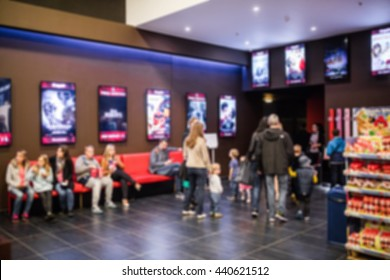 People  waiting for movie at cinema