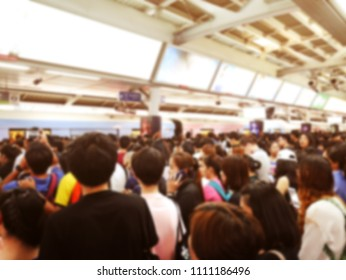 People waiting for the train after work in the capital city. blur picture for background concept.