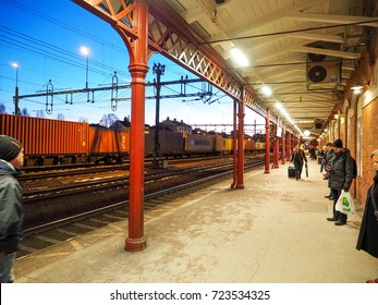 People waiting train from Karlstad central railway station on evening after sunset time, Karlstad, Sweden, 20 Feb 2016. (in winter season)