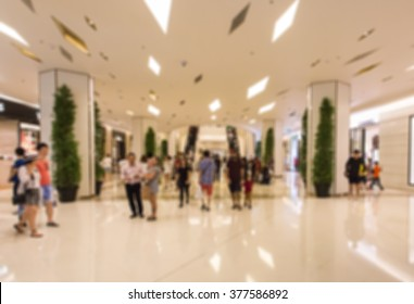 People wake  in the mall blur
