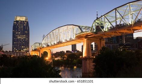 People Walk Across Cumberland River Pedestrian Bridge Nashville Tennessee