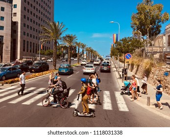 People walk along the pedestrian crossing in Tel Aviv . Israel ,Tel Aviv ,May 2018.