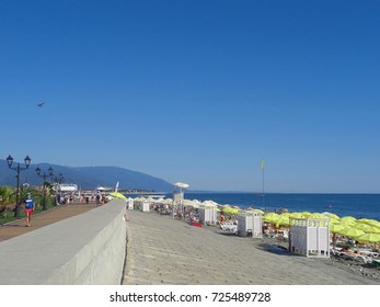 People walk along promenade and relax at the beach, resort Sochi, Russia, September 9, 2017