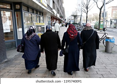 People walk in central streets of  Amsterdam, Netherlands on March 13, 2017