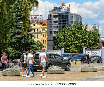 People walk in the city. Building of PWC company in Sofia. Insurance, advisory, tax service. Urban cityscape of European cities. Bulgaria, Sofia – June 10, 2017