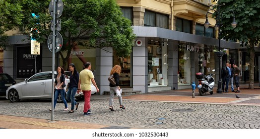 People walk in the city. Urban cityscape of European cities. Modern view of wonderful buildings and stores in Bulgaria. Bulgaria, Sofia - June 9, 2017