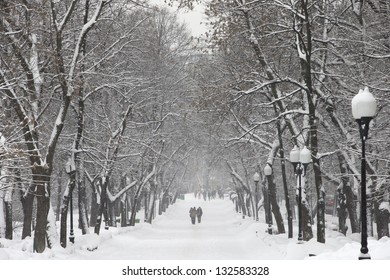 People walk during snowfall in cold day in winter in Moscow