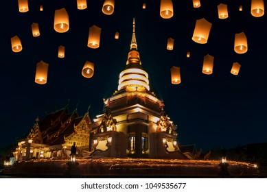People walk with lighted candles to respect Buddha at thailand