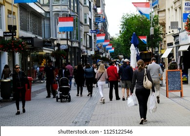 People walk in main street of  Luxembourg city on Jun. 22, 2018.