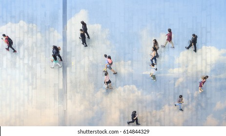 people walk on across the pedestrian concrete landscape with the hardscape reflect the cloud and blue sky (wide angle of aerial top view)
