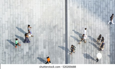 People walk on pathway concrete landscape of top view city street with silhouette shadow on the ground