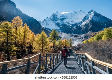 People walk on the way in Yading National Park, Daocheng, Sichuen, China.