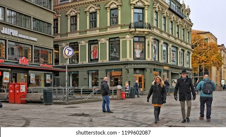 People walk in Oslo downtown. Norwegian streets with buildings and stores. W.B. Samson store. Auster academy. Scandinavian stores. Norway, Oslo – November 4, 2017